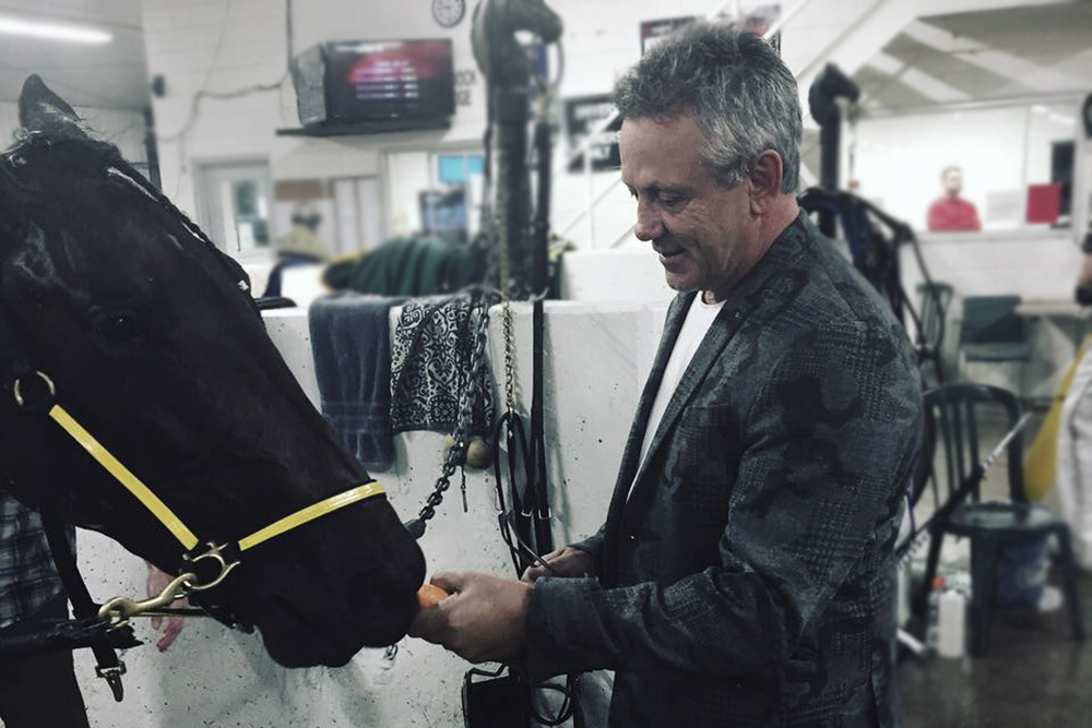 NHL hockey alumni Doug Gilmour with Standardbred racehorse