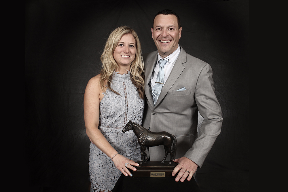 Amy & Anthony MacDonald posing with Cam Fella Award trophy